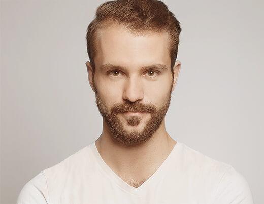 Bewerbungsfotos München Mann mit dem Bart frontal